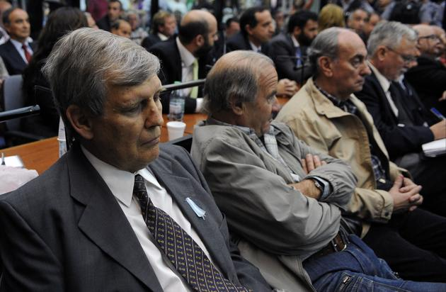 "Alfredo Astiz (left), nicknamed ""Blond Angel of Death"" during Argentina's military dictatorship, at his sentencing in Buenos Aires on November 29, 2017.(AFP)"
