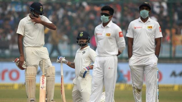 Sri Lanka cricket players wear masks in an attempt to protect themselves from air pollution during the India vs Sri Lanka third Test.(AFP)