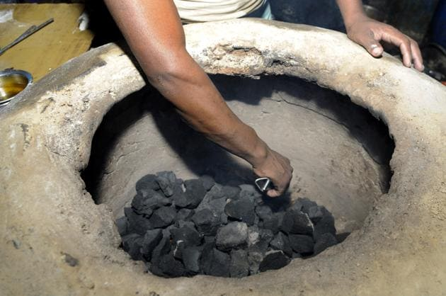 To realise India's voluntary commitment as part of the 2015 Paris climate agreement, the Bharatiya Janata Party government introduced the Pradhan Mantri Ujjwala Yojana, which aims at provisioning cleaner liquefied petroleum gas cylinders to poor households(Sunil Ghosh / Hindustan Times)