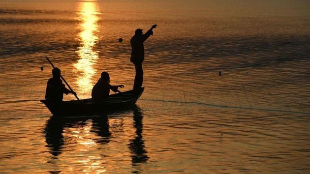 Fishermen at the Brahmaputra river during sunset in Guwahati.(AFP File Photo)