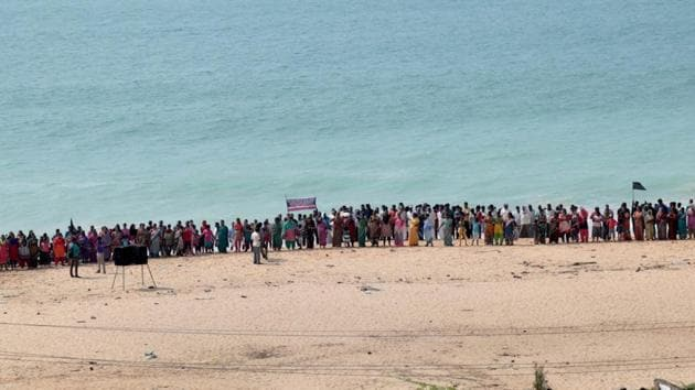 Family members of various fishermen, who are still missing following cyclone Ockhi, stage a protest near the sea shore seeking central and state government agencies to step up the search operations in Kanyakumari on December 10.(PTI Photo)