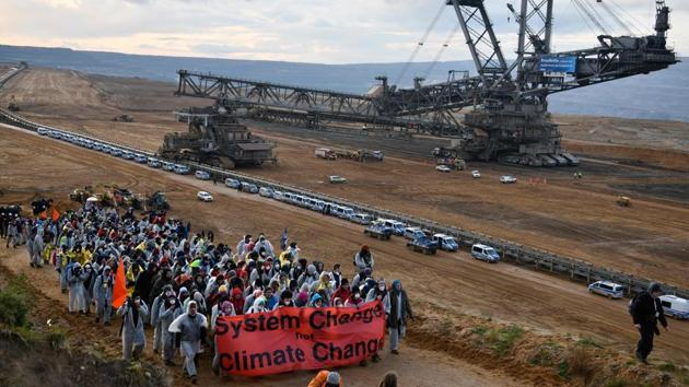 Environmentalists demonstrate at the Hambach lignite open pit mine near Elsdorf, Germany, on November 5, during a protest against fossil-based energies like coal, having negative impact on the climate change.(AFP file)