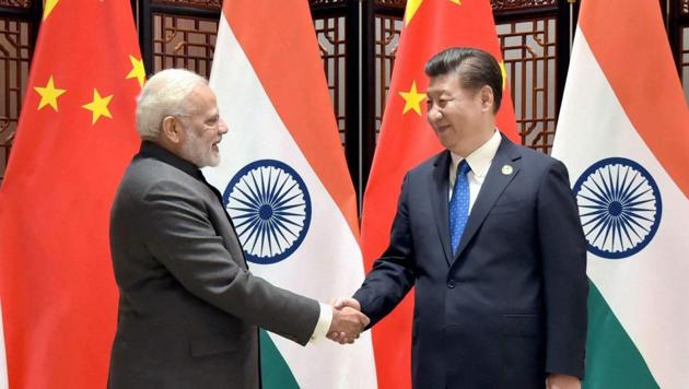 Prime Minister Narendra Modi meets Chinese president Xi Jinping on the sidelines of the 9th BRICS Summit in Xiamen, China, on Tuesday.(PTI Photo)