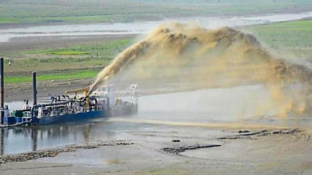 Dredging under way in the river.(HT Photo)