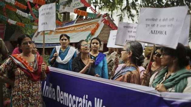 An activist of All India Democratic Women's Association (AIDWA) speaks during a protest against the rape and murder of a Dalit woman in Kerala in New Delhi on May 4, 2016(AP File Photo)