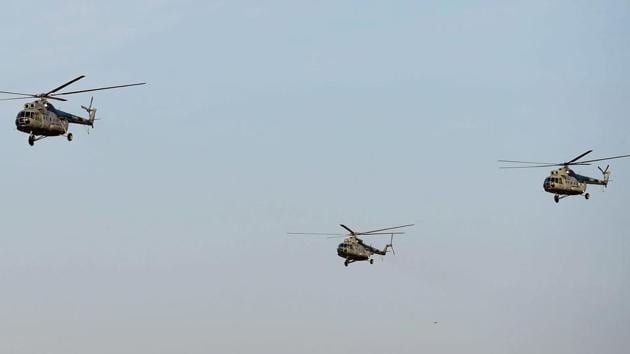 """Bengaluru : A fleet of MI 8 """"Pratap"""" helicopters on their last sortie for the formal adieu to the Multi-role helicopter during the phasing out ceremony at the Yelahanka Air base in Bengaluru on Sunday. PTI Photo by Shailendra Bhojak(PTI12_17_2017_000161B)(PTI)"""