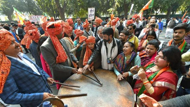 BJP workers and supporters celebrate party's success in Gujarat and Himachal Pradesh assembly elections, in New Delhi.(PTI Photo)