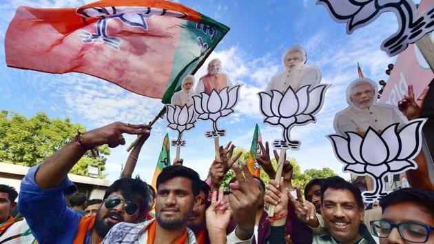 BJP workers celebrate their victory in the Assembly elections, at the party office Gandhinagar, December 19(PTI)