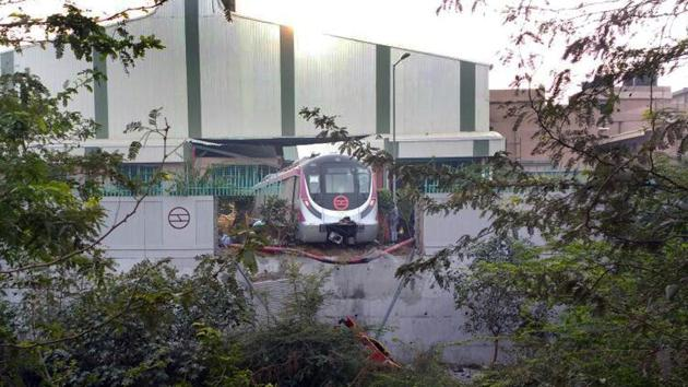 The Magenta Line train broke through a boundary wall at the Kalindi Kunj depot during a trial run on Tuesday afternoon(Ht photo)