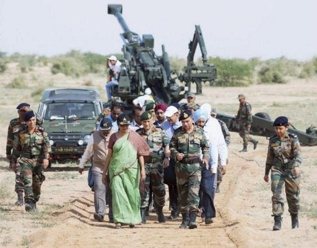 A file photo shows defence minister Nirmala Sitharaman with the army chief General Bipin Rawat and other officers after witnessing firing of ATAGS at Pokhran in Rajasthan in September.(PTI FILE PHOTO)