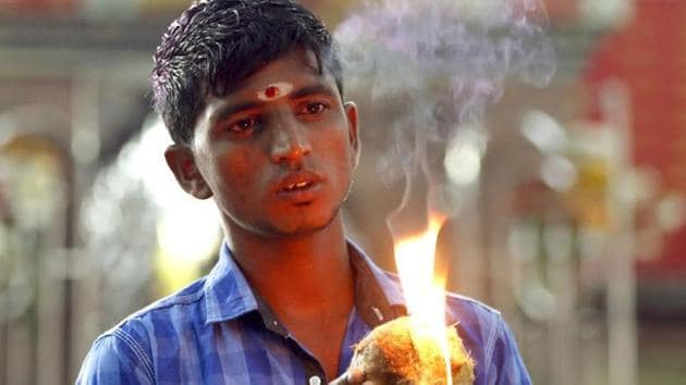 A Sri Lankan ethnic Tamil boy prays during a Hindu temple procession marking the Pongal festival in Colombo.(AP File Photo)