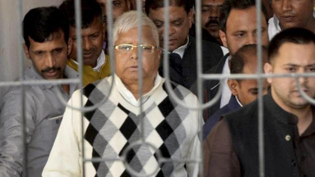 Rashtriya Janata Dal supremo Lalu Prasad Yadav being escorted by police officials after being convicted by the special CBI court in a fodder scam case, in Ranchi, on Saturday.(PTI)