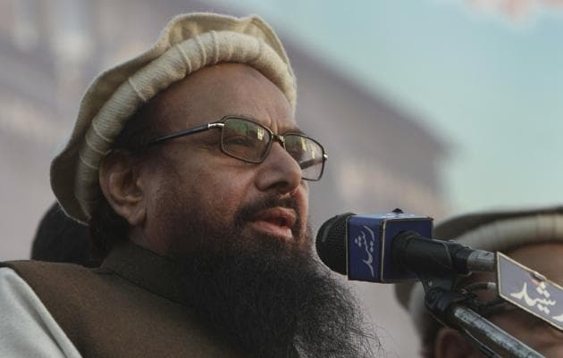 JuD chief Hafiz Saeed addressing an anti-America rally in Lahore on December 17, 2017.(AP)