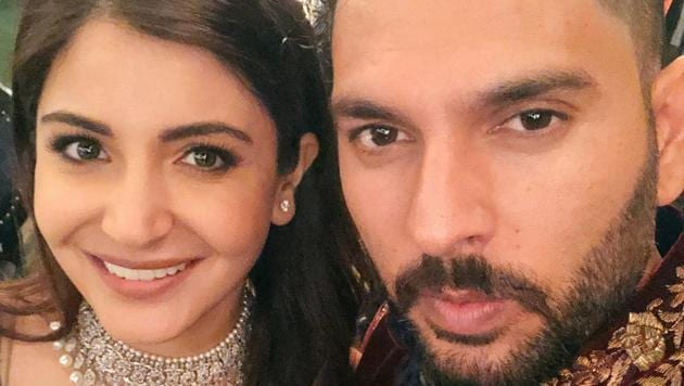 Anushka Sharma poses with Yuvraj Singh during her wedding reception in Mumbai on Tuesday night.(Yuvraj Singh/Twitter)