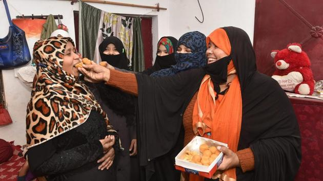 Muslim women celebrating the introduction of triple 'talaq' bill in the Lok Sabha in Lucknow on Thursday.(PTI Photo)