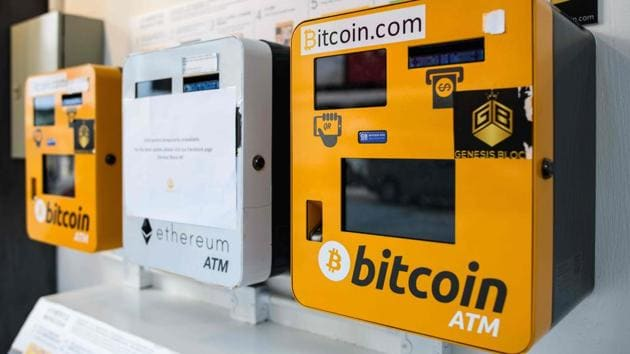 ATM machines (L and R) for digital currency Bitcoin are seen in Hong Kong on December 18, 2017. Bitcoins' market price is almost certain at some point to crash and burn, just as the dot-coms did.(AFP Photo)