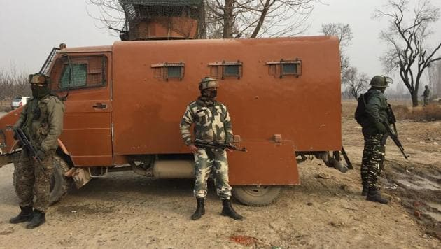 Security personnel stand guard after an attack on a CRPF camp at Lethpora in south Kashmir on Sunday.(Waseem Andrabi/HT Photo)