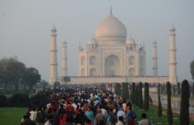 At present, the gates Taj Mahal open at sunrise and close at sunset.(HT Photo)