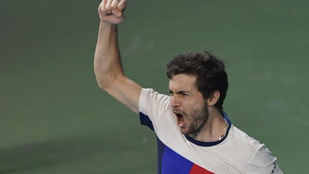 Gilles Simon of France celebrates after beating Kevin Anderson of South Africa to win the men's single title at the Tata Open Maharashtra ATP tennis tournament in Pune on Saturday.(AFP)