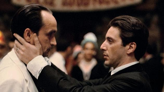 Al Pacino as Michael Corleone (R) and John Cazale as Fredo.