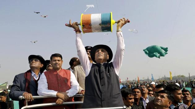 Gujarat chief minister Vijay Rupani flies a kite during the inauguration of the 29th International Kite Festival in Ahmedabad on Sunday. This state government-sponsored festival will culminate on January 14, which is celebrated as Makar Sankranti. (PTI)