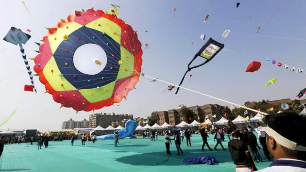 Kites take to the skies after the festival's inauguration. Dragon kites and setups of hundreds of kites tied to a single string hogged the limelight on inaugural day. (PTI)