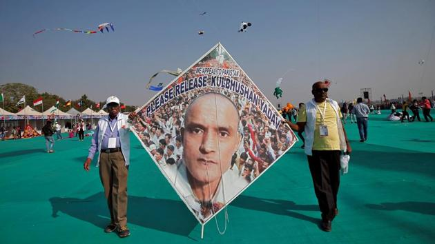 Kite-flying enthusiasts hold up a kite with an image of Kulbhushan Sudhir Jadhav, a former officer in the Indian Navy, who was arrested in March 2016 in the Pakistani province of Baluchistan, at the festival. Besides Ahmedabad, the festival will also be celebrated in other cities in the state, including Jamnagar, Surat, Dwarka, Rajkot, Vadodara and Gandhidham. (Amit Dave / REUTERS)