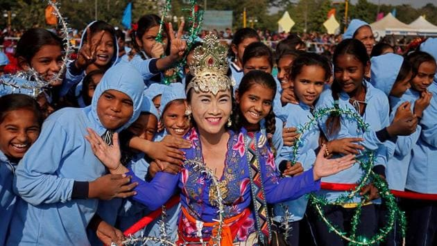 Sarjiyanto Helmi Ginanti, a kite-flier from Bali, Indonesia poses with schoolchildren on day one of the festival. This year about 535 kite fliers are participating in the festival. (Amit Dave / REUTERS)