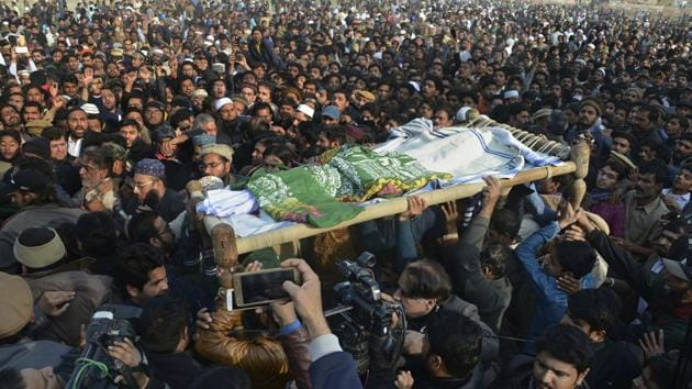 People attend a funeral of a Pakistani girl who was raped and killed, in Kasur, Pakistan.(AP Photo)