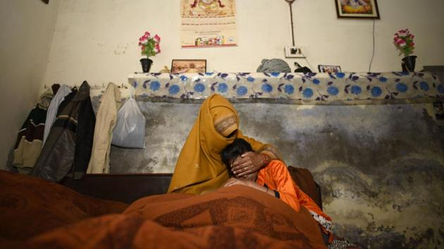The mother and younger sister of the rape-murder victim at their village in Jhansa in Haryana.(Burhaan Kinu/HT Photo)