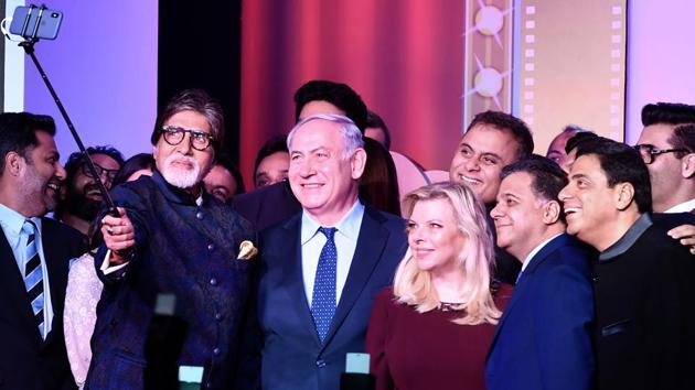 Actor Amitabh Bachchan takes a selfie with Israeli Prime Minister Benjamin Netanyahu (centre), his wife Sara and other guests at the Shalom Bollywood event in Mumbai on Thursday.(AFP Photo)
