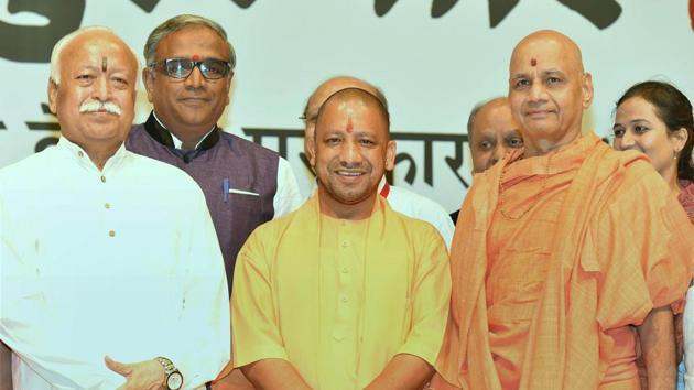 Uttar Pradesh Chief Minister Yogi Adityanath and RSS chief Mohan Bhagwat at the annual Bharatatma Ashokji Singhal Vedic Awards 2017 function in New Delhi.(PTI File Photo)