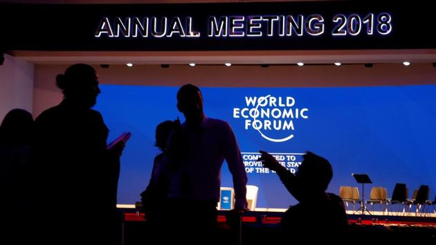 Staff talk in the Congress Hall ahead of the World Economic Forum (WEF) annual meeting in the Swiss Alps resort of Davos, Switzerland(REUTERS)