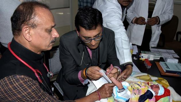 JK Lone Hospital Medical Superintendent Dr Ashok Gupta (left) with Newborn Screening Laboratory in-charge Dr Priyanshu Mathur on Monday.(Prabhakar Sharma/HT PHOTO)