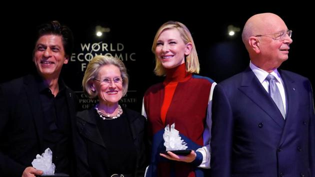 Actor Cate Blanchett and actor Shah Rukh Khan pose for the media after receiving the Crystal Awards, with Hilde Schwab, chairperson and co-Founder of Schwab Foundation for Social Entrepreneurship, and Klaus Schwab, founder and executive chairman of the WEF, at the annual meeting of the World Economic Forum (WEF) in Davos.(REUTERS)