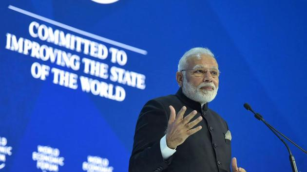 Prime Minister Narendra Modi delivers his speech at the plenary session of the World Economic Forum, in Davos on Tuesday.(PTI Photo)