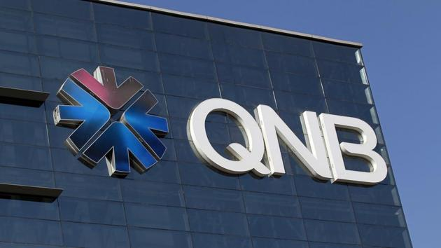 The logo of Qatar National Bank is seen on its building in Doha, Qatar.(REUTERS FILE)