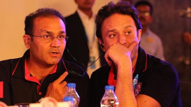 Kings XI Punjab mentor Virender Sehwag and Ness Wadia during the first day of the IPL auction 2018 in Bangalore on Saturday.(BCCI)
