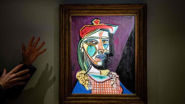 """Pablo Picasso's painting """"Woman in beret and checked dress (Marie-Therese Walter)"""" is displayed at a media preview for the Sotheby's London's Impressionist & Modern Art Evening Sale in Hong Kong on Tuesday. The painting will be auctioned on February 28.(AFP)"""