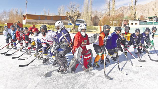 Members of the women's ice hockey team of India play at Karzu Ring in Leh. The players are aged between 15-30, and are being trained by four-time Olympic gold medallist from Canada, Hayley Wickenheiser.(Sanchit Khanna/HT PHOTO)