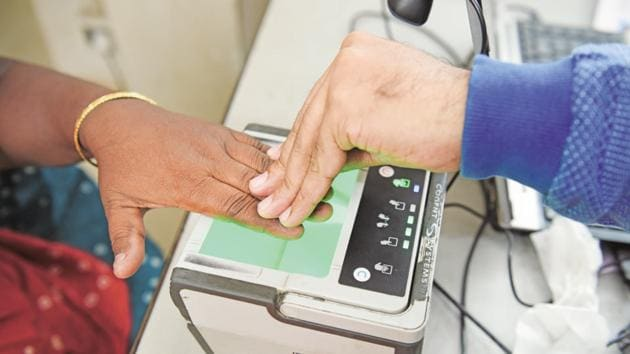 The beneficiaries had to provide their finger print, details of his ration card and UID (Aadhaar) numbers to match the data fed into the computer. This would generate a slip on the basis of which he was given subsidised ration every month.(MInt File Photo)