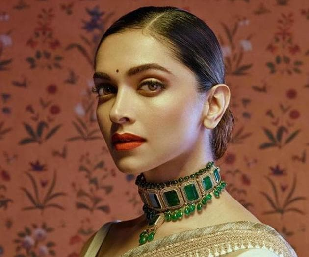 The dreamy florals on Sabyasachi's wallcoverings are beautifully feminine. But, we are especially loving actor Deepika Padukone's whimsy in this photo the designer shared on Sunday. (Instagram/ sabyasachiofficial)
