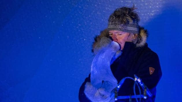 Terje Lsungset, the founder and artistic director of the Ice Music Festival, performs with a musical instrument made purely of ice.(AFP)