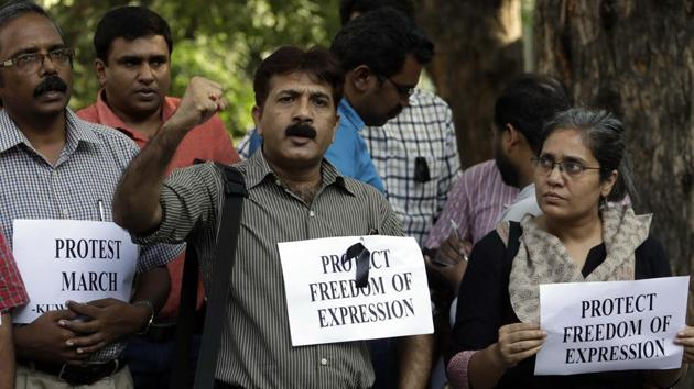 Journalists shout slogans during a protest in New Delhi against the killing of TV journalist Shantanu Bhowmick, who was abducted and killed while covering a protest rally in Tripura .(AP File Photo)