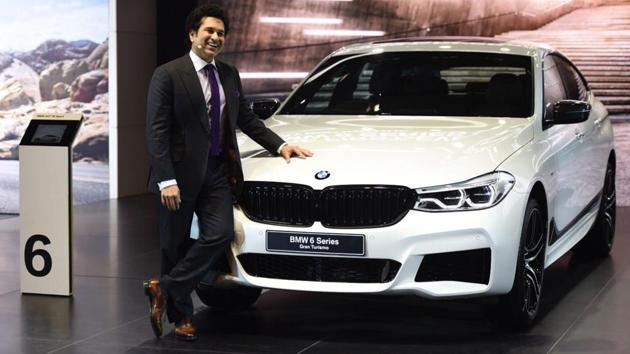 The 14th edition of the biennial Auto Expo kicked off in Greater Noida's India Expo Mart on Wednesday, with a slew of launches on the opening day. Sachin Tendulkar made an appearance at the event as BMW unveiled the 6 series Gran Tourismo. Here's what's in store for visitors to the 14th edition of the expo. (Burhaan Kinu / HT Photo)
