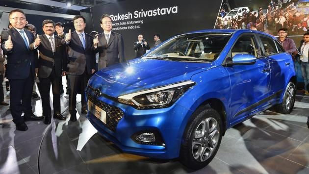 Hyundai MD and CEO YK Koo (2R), along with company officials, showcases a premium compact hatchback Elite i20 at Auto Expo 2018. The car will come with a three-year/1,00,000km warranty and a three-year roadside assistance. (Kamal Singh / PTI)