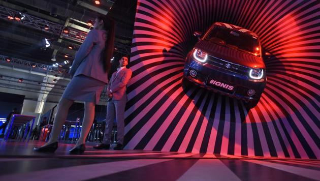 Maruti Suzuki's IGNIS car on display during Auto Expo motor show in Greater Noida on Wednesday. Maruti Suzuki India CEO said that the company will launch its first electronic vehicle in India in 2020. (Burhaan Kinu/HT PHOTO)