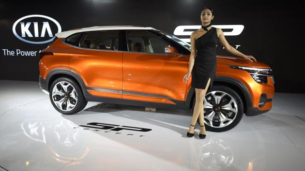 Models showcase KIA Motors Corporation's SP Concept car at the Auto Expo. The company introduced its global models announcing its entry into the Indian market. Kia will be launching vehicles tailored to the Indian market. (Burhaan Kinu / HT Photo)
