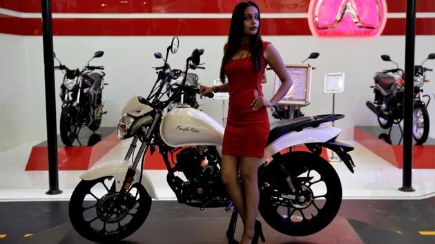 A model poses with Indian automobile manufacturer Aftek Motors' motorcycle Knight Rider 170CC. Aftek Motors' is one of the 12 electric vehicle startups participating in Auto Expo 2018. (Altaf Qadri / AP)