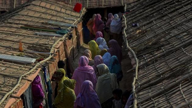 """This photograph taken on January 26, 2018 shows women walking inside the """"widow's camp"""" at the Balukhali refugee camp in Bangladesh's Ukhia district.(AFP Photo)"""